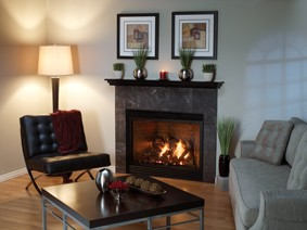 Luxury Direct-Vent Fireplace with Custom Mantelshelf and Slate Tile Surround